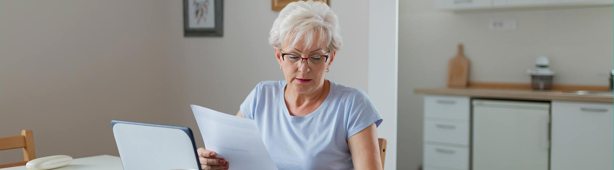 Older woman using laptop to check her finances